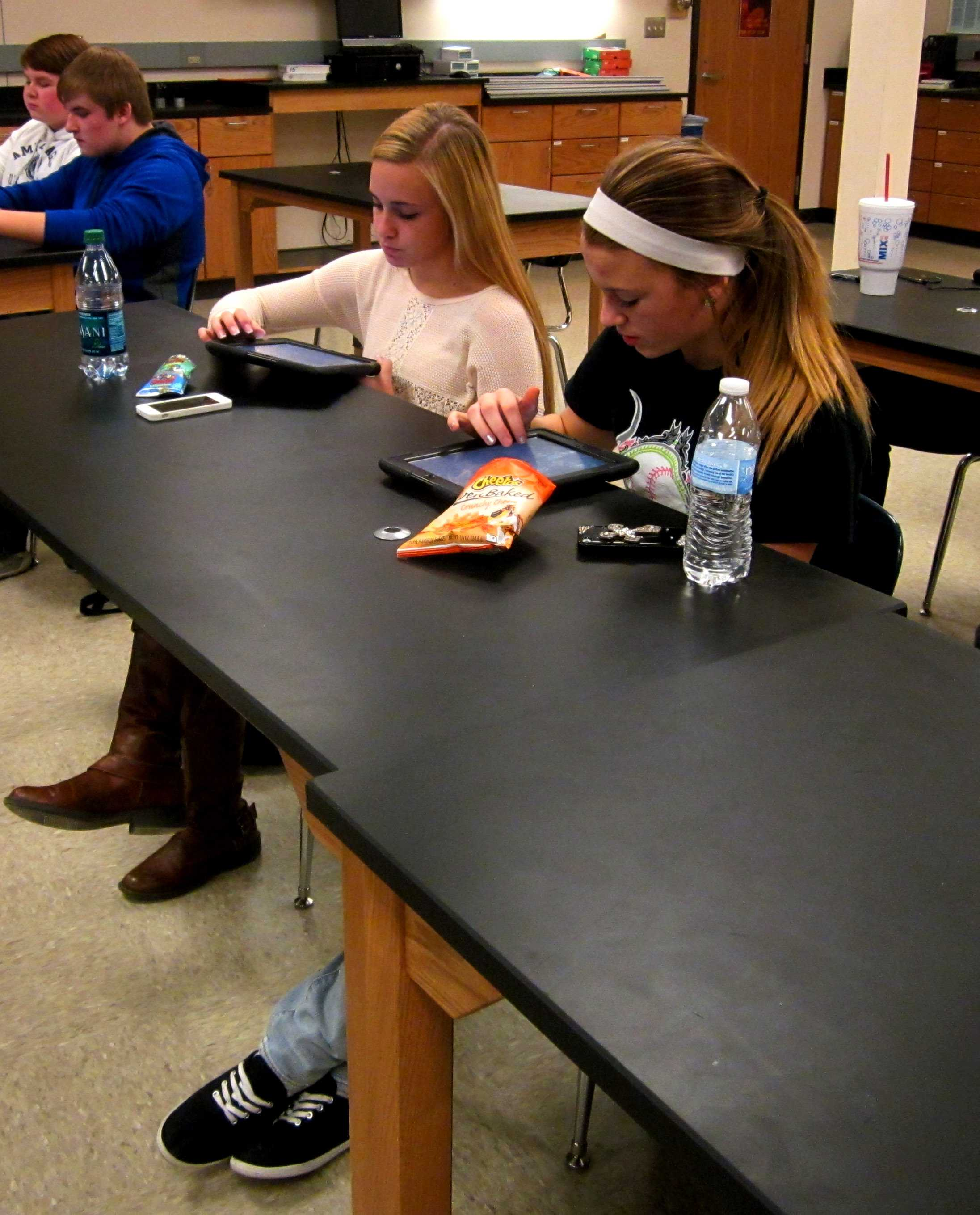 Juniors Payton Reynolds and Nicole Robinett work together on an assignment using their iPads.